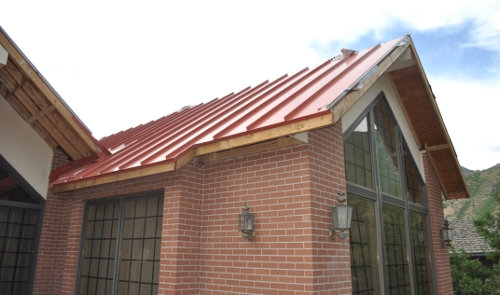 Metal roofing utah aspen roofing for Metal roof pictures brick house